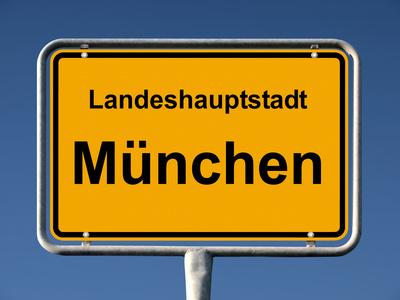 Ortsschild München - Kauf und Verkauf von Immobilien in München